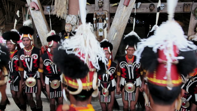 MS Shot of Chang tribesmen dressed in traditional costume and dancing at Hornbill festival AUDIO / Nagaland, India
