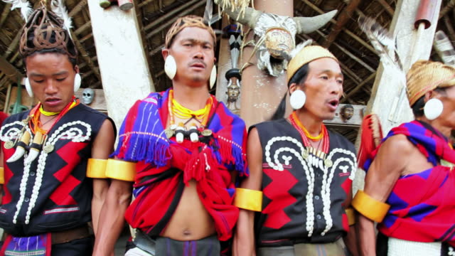 MS PAN Shot of Chang tribesmen wearing traditional costume tribal dancing festival AUDIO / Nagaland, India