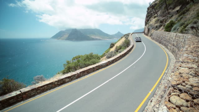 WS PAN Shot of Chapman's Peak Drive as car driving with hill area / Cape Town, Western Cape, South Africa