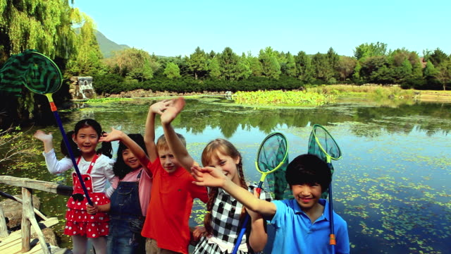 ms shot of cheering children at park / paju, gyeonggido, south korea - five people stock videos and b-roll footage