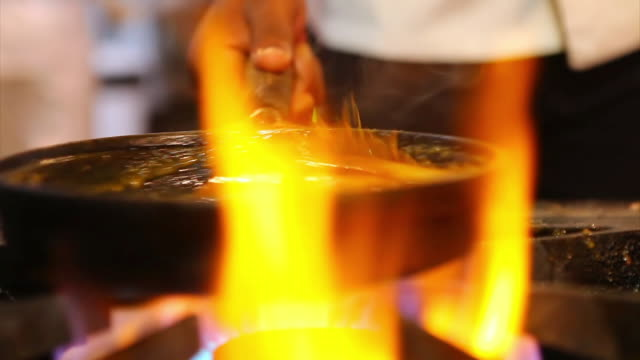 cu r/f shot of chef cooking bananas and grilling meat / belo horizonte, minas gerais, brazil - cooker stock videos and b-roll footage
