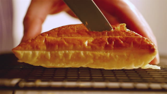 cu shot of chef cutting lid of cooking pastry / newport, south wales, united kingdom - pastry dough stock videos & royalty-free footage