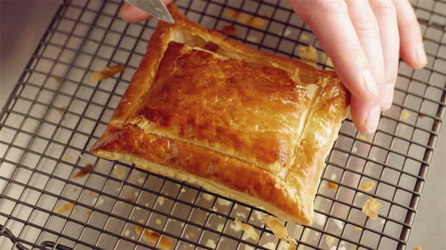 cu shot of chef removing lid from cooked pastry / newport, south wales, united kingdom - wales stock videos & royalty-free footage