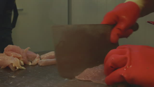 cu shot of chicken being cutting in man in market / taipei, taiwan - chopping stock videos & royalty-free footage