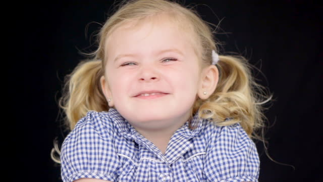 cu shot of child smiling / london, united kingdom - one girl only stock videos & royalty-free footage