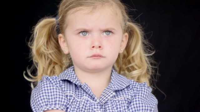 cu shot of child with unusual confusing expression / london, united kingdom - gereiztheit stock-videos und b-roll-filmmaterial