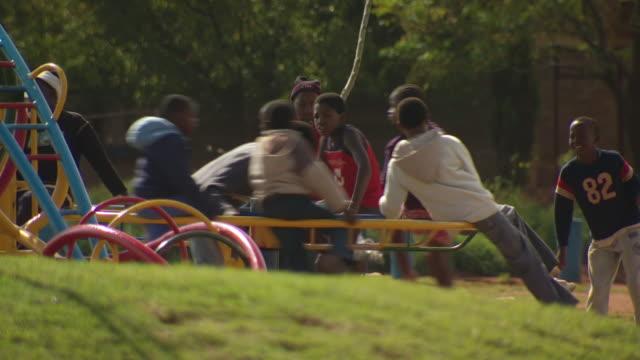 vídeos y material grabado en eventos de stock de ms shot of children playing on playground / durban south africa - kwazulu natal