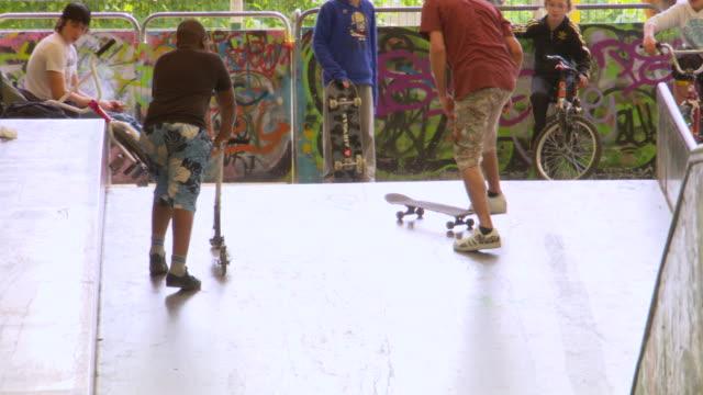 ms tu td shot of children playing skateboard / paris, france - stunt stock videos & royalty-free footage