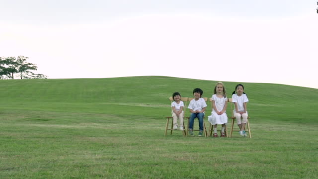 ms shot of children sitting on chair and smiling / seoul, south korea - chair stock videos & royalty-free footage