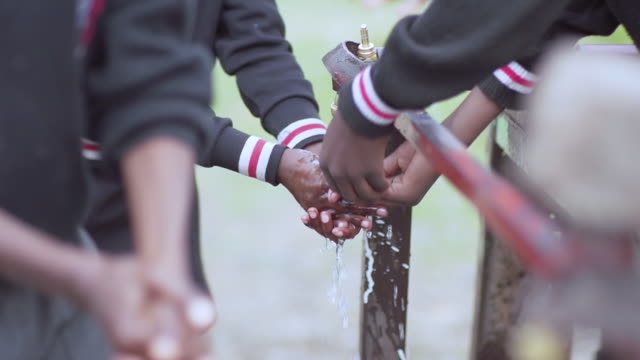 ms shot of children washing their hands under running water / witbank, mpumalanga, south africa - running water stock videos & royalty-free footage