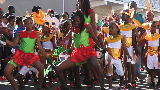 MS Shot of Childrens carnival parade AUDIO / Nevis, Saint Kitts and Nevis