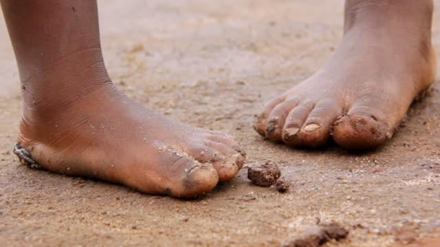 CU Shot of children's feet / Lukuzi, Eastern, Zambia