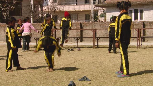 ms shot of children's playing of papa's house / kathmandu nepal - waisenhaus stock-videos und b-roll-filmmaterial