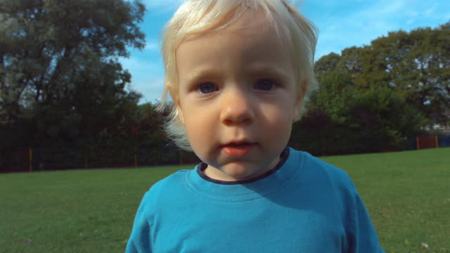 cu slo mo shot of child's face - blue eyes stock videos and b-roll footage