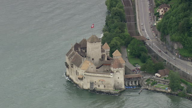WS AERIAL ZI ZO Shot of chillion castle / Vaud, Switzerland