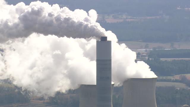 ms aerial shot of chimney and smoke / georgia, united states - smoke stack stock videos & royalty-free footage
