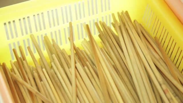 cu shot of chopsticks in plastic basket / shenzhen, guangdong, china - chopsticks stock videos & royalty-free footage