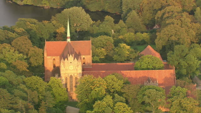 MS AERIAL Shot of Chorin Abbey with surrounded by trees / Germany