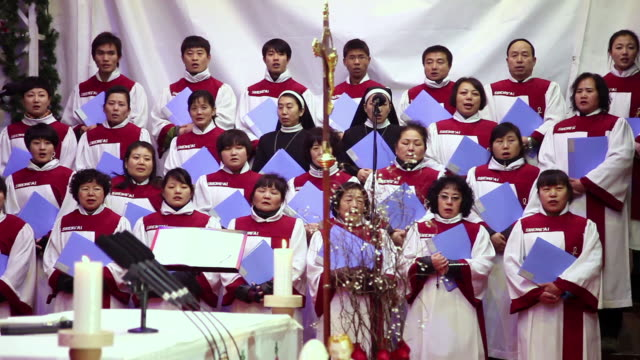 MS Shot of Christians singing anthems in church at Christmas evening / Xian, China