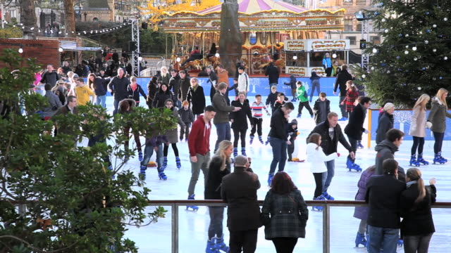 ms shot of christmas ice skating at natural history museum / london, united kingdom - ice rink stock videos and b-roll footage