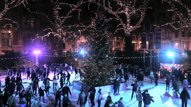 ms shot of christmas ice skating near natural history museum at night / london, united kingdom - ice rink stock videos & royalty-free footage