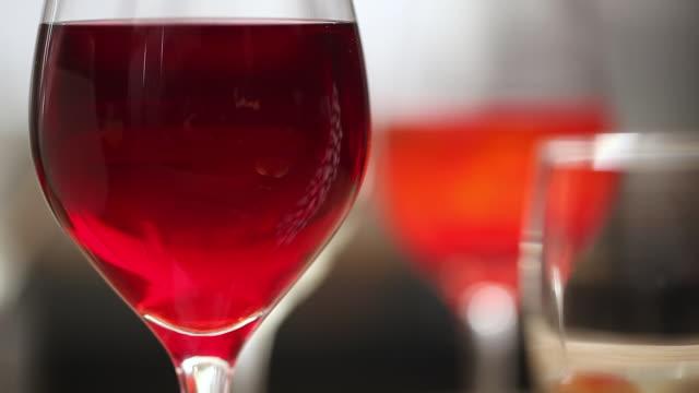 cu r/f pan shot of christmas ornament and red wine / seoul, south korea - 雑貨点の映像素材/bロール