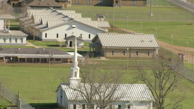 ms aerial tu zi zo shot of church at louisiana state penitentiary / angola, louisiana, united states - prison building stock videos & royalty-free footage