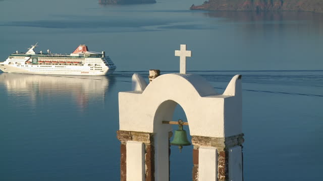 CU Shot of church bell and cuise ship moving in Ocean at Oia / Santorini, Cyclades, Greece