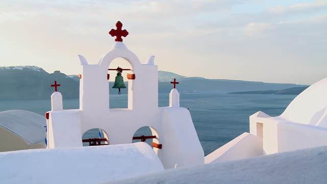 MS Shot of church bells at village Oia / Santorini, Cyclades, Greece