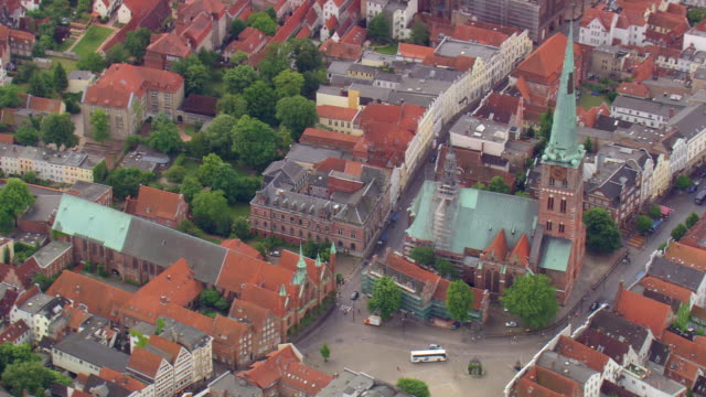 ms aerial shot of church, houses and road way at lubeck / germany - lübeck stock-videos und b-roll-filmmaterial