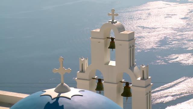 ms zo shot of church in firostefani with ocean / santorini, cyclades, greece - greek islands stock videos and b-roll footage