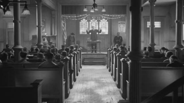 ms shot of church interior during church service - priest stock videos and b-roll footage