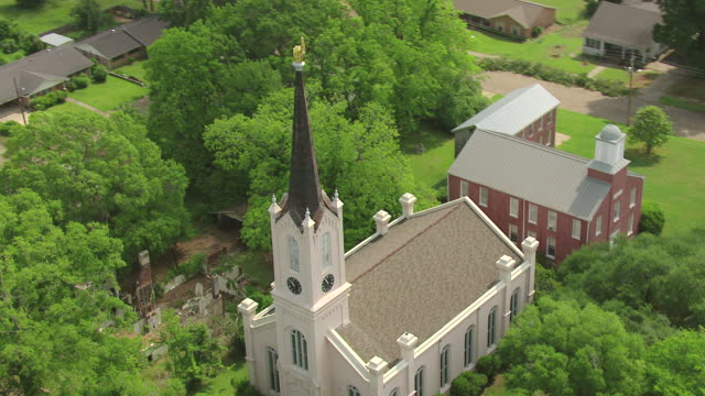 MS AERIAL ZO Shot of church steeple of First Presbyterian Church and buildings / Port Gibson, Mississippi, United States