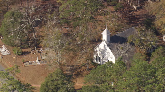 ms aerial shot of church surrounded by tress in old clinton district / georgia, united states - religious cross stock videos & royalty-free footage