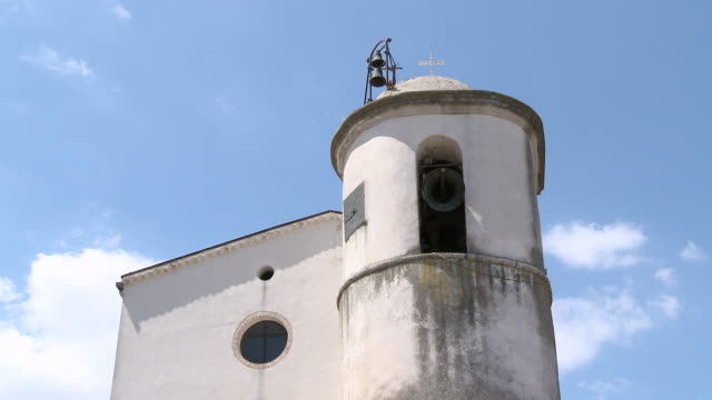 ws shot of church with bell tower / san polo matese,  molise, italy - bell tower tower stock videos and b-roll footage