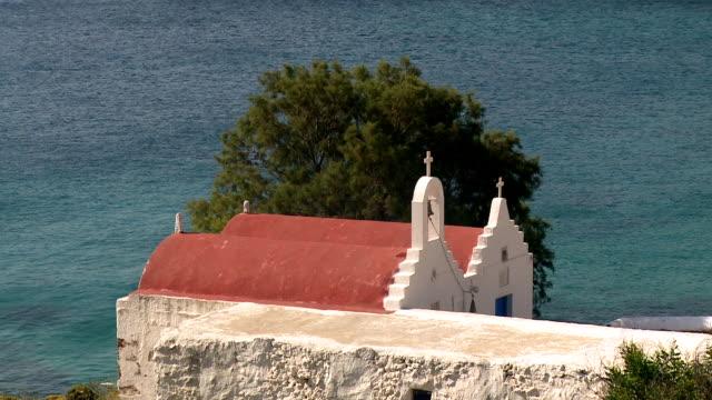 ms shot of church with ocean at agios sostis, panormos bay / mykonos, cyclades, greece - mykonos stock videos & royalty-free footage