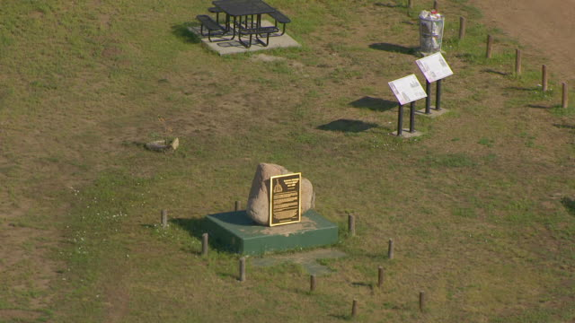ms aerial ts zo shot of circle sitting bull burial site and fort yates and pull out / north dakota, united states - 飾り板点の映像素材/bロール