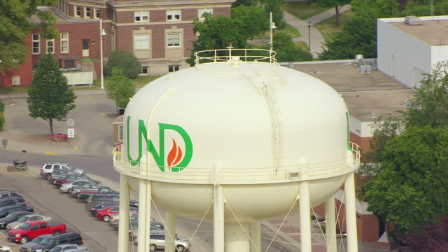 CU AERIAL TS ZO Shot of Circle UND water tower and pull out to campus / Grand Forks, North Dakota, United States