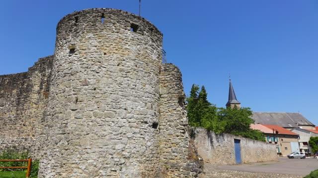 ms la shot of citadelle with church / rodemack, lorraine, france - lorraine stock-videos und b-roll-filmmaterial