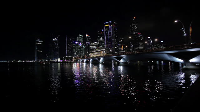 MS Shot of city from across water with bridge / Singapore