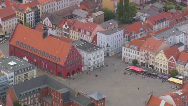 MS AERIAL Shot of city hall and central market square of Greifswald / Germany