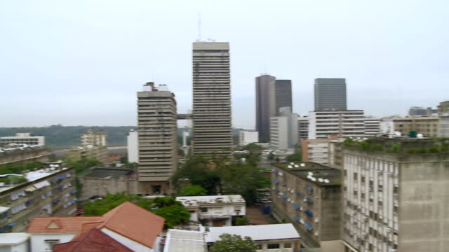 ws pan shot of city in cote d'ivoire / ivory coast - côte d'ivoire stock videos & royalty-free footage
