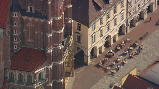 ms aerial shot of city of landshut and church of st. martin with people at landshut / germany - german culture stock videos & royalty-free footage