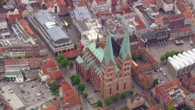 ms aerial shot of city of lubeck with river / germany - lübeck stock-videos und b-roll-filmmaterial