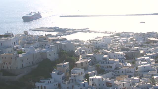 MS AERIAL TS Shot of city of naxos and coastline / Naxos, Cyclades, Greece