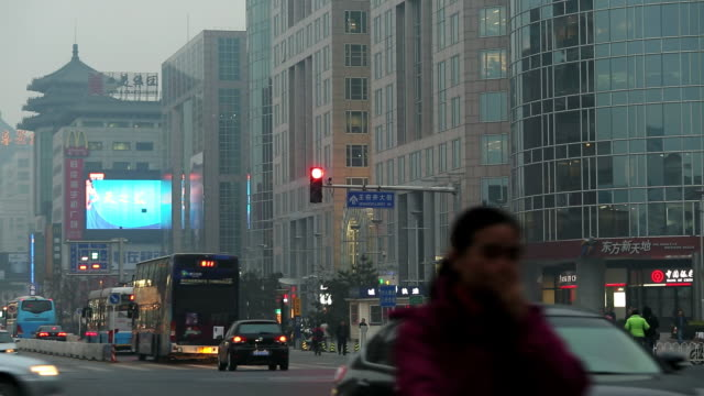 MS Shot of City smog and pollution at dusk Wangfujing shopping street / Beijing, Hebei Province, China