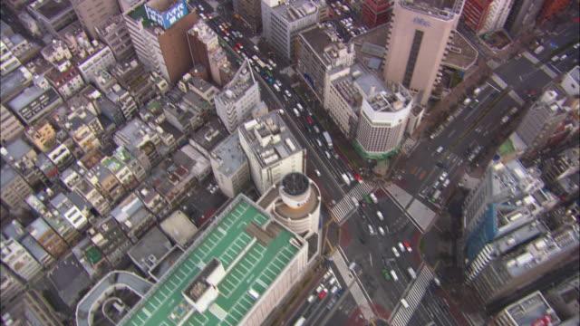ms pov aerial shot of city / tokyo, japan - tokyo japan stock-videos und b-roll-filmmaterial