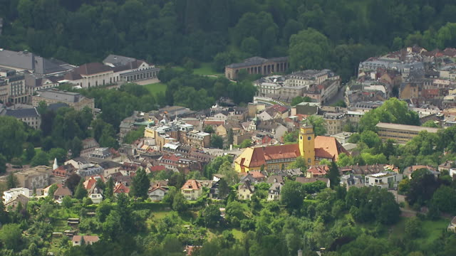 ms aerial pan shot of city with kurhaus casino and surrounding area / baden baden, baden wurttemberg, germany - wiesbaden stock-videos und b-roll-filmmaterial