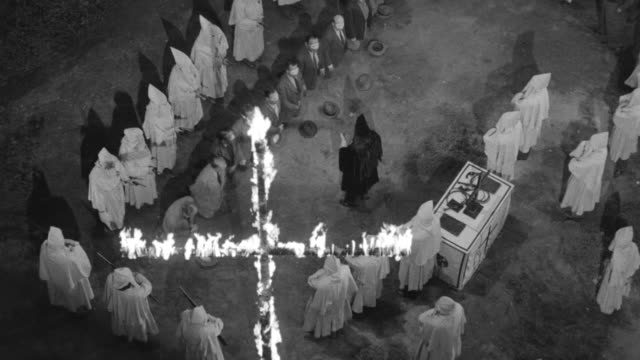 ms shot of clan rally in woods with cross burning - ku klux klan stock videos and b-roll footage
