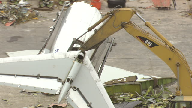 cu aerial zo shot of claw throws md80 commercial jet airliner tail into pile of rubble / roswell, new mexico, united states - roswell stock videos & royalty-free footage